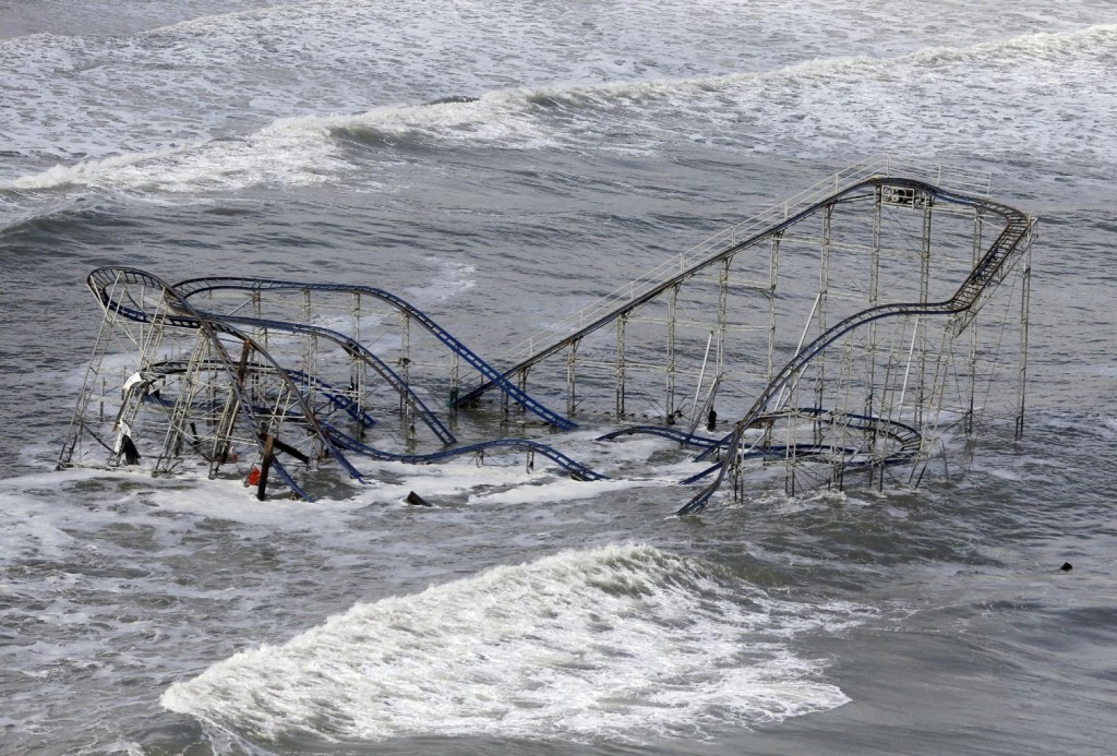 FILE - In this Wednesday, Oct. 31, 2012 file photo, waves wash over a roller coaster from a Seaside Heights, N.J., amusement park that fell in the Atlantic Ocean during Superstorm Sandy. (AP Photo/Mike Groll, File)