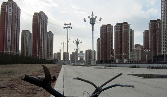 An empty street in front of a vacant residential complex in the city of Kangbashi, Ordos. The difference from last report in 2012 is that real estate prices in Kangbashi have plummeted since 2010 and continue to do so. Dozens of migrant workers rent vacant office spaces as apartments for as low as $65 a month.UNHEARD OF!