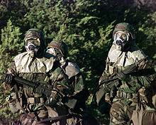 U.S. soldiers wearing full chemical protection