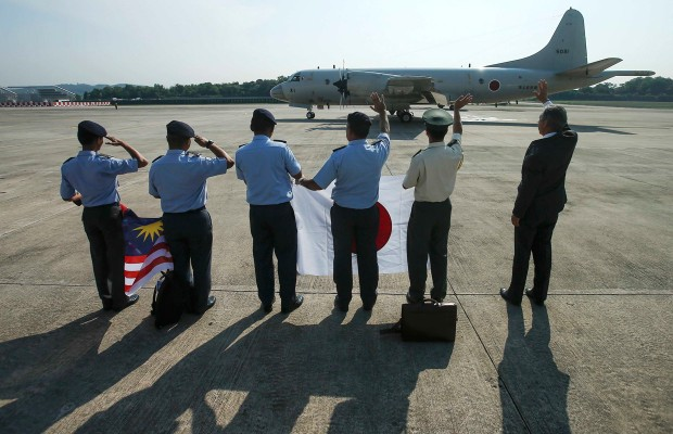 MISSING JET:Makio Miyagawa (R), Japanese ambassador to Malaysia, Hideki Jufuku (2nd R), commander of Japan's Maritime Self-Defense Force and Royal Malaysian Air Force members wave to Japan Maritime Self-Defense Force P3C crew. Photo: Reuters -  The Truth Denied Report
