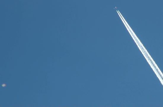 September 21, 2012. Still removed from video footage of a UFO buzzing a chemtrail jet.