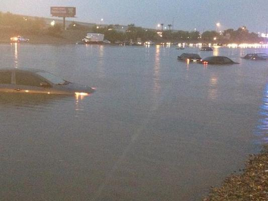 floodDozens of cars underwater on I-10 near 43rd Ave (@JillGalus)