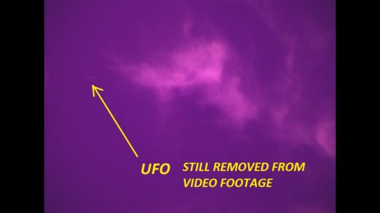 UFO Still from Full Spectrum Video Footage. Ufo traveling in and around clouds. Antelope Valley, Ca. Photo by Jim Kerr.