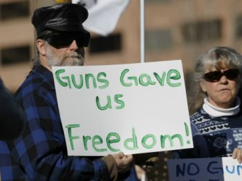 guns-gave-freedom-sign-ap